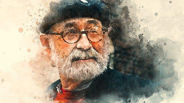Starší muž v brýlích s čepicí na hlavě